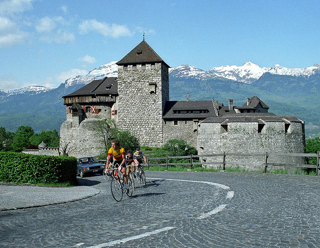 by claustral on Flickr.Cyclists climbing past Vaduz Castle, Liechtenstein.