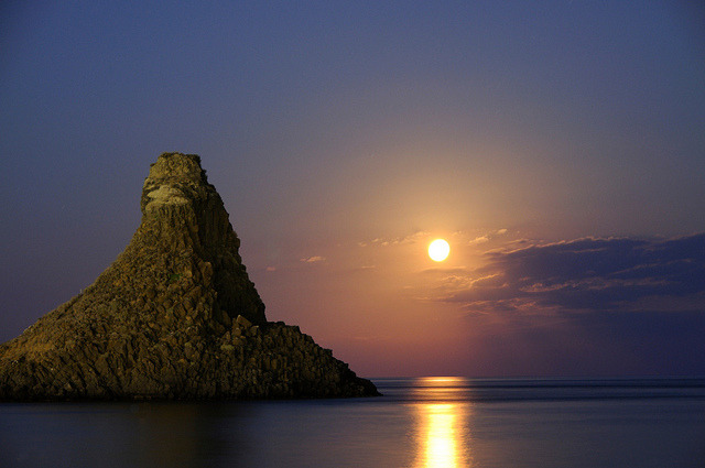 by gnuckx on Flickr.Aci Trezza Faraglioni moon rise, Islands of the Cyclops, Sicily, Italy.