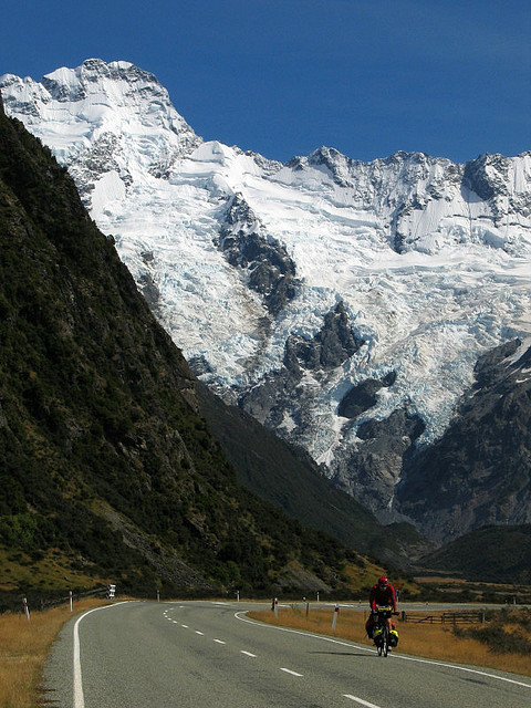 Cyclist on the road to Mount Cook in South Island, New Zealand