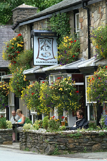 Enjoying a drink outside the Tanronnen Inn in Beddgelert, Wales