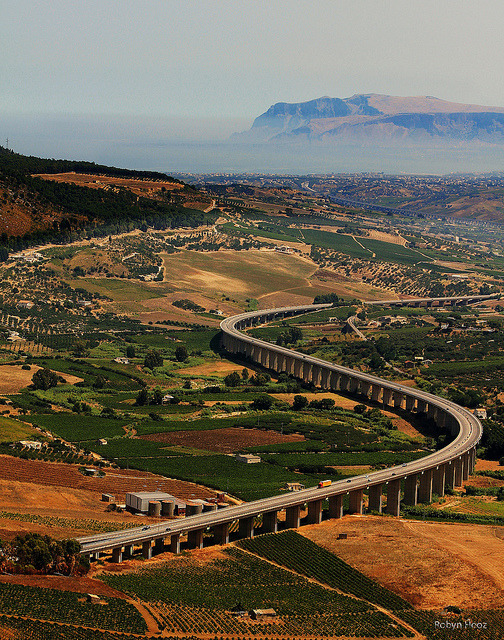The highway viaduct seen from the temple of Segesta in Sicily, Italy